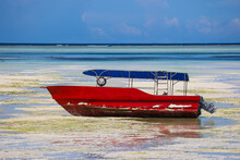Tourist Boat At Low Tide On Paje Beach