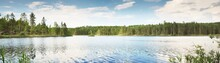Blue Saimaa Lake, Rocky Shores, Evergreen Forest. Finland. Picturesque Panoramic Scenery. Reflections In The Water. Atmospheric Landscape. Pure Nature, Ecology, Environment, Travel Destinations