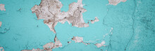 Peeling Paint On The Wall. Panorama Of A Concrete Wall With Old Cracked Flaking Paint. Weathered Rough Painted Surface With Patterns Of Cracks And Peeling. Wide Panoramic Grunge Texture For Background