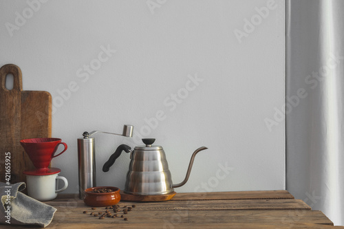 Coffee brewing equipment on the kitchen table. Fotobehang