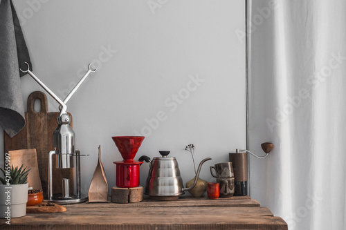 Canvas Coffee brewing equipment with drip kettle, manual grinder, drip, espresso machine on wooden boards