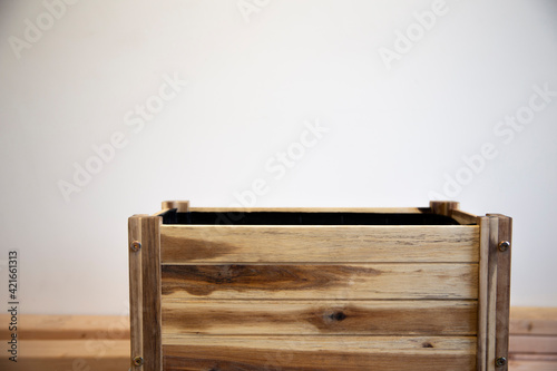 wooden empty rectangular pot for plants on white wall background Tapéta, Fotótapéta