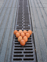 Vertical Shot Of Ten Chicken Eggs On The Street Sorted Like Billiard