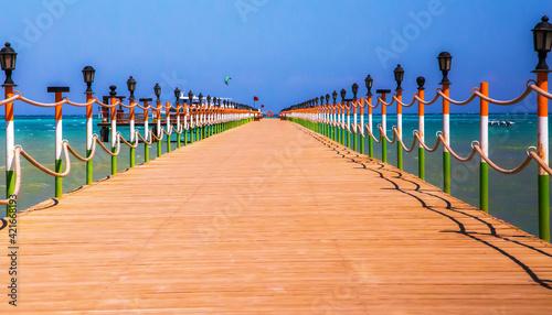 Footpath By Sea Against Clear Sky Fotobehang