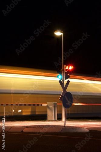 Illuminated Railway Signals Moving Train At Night