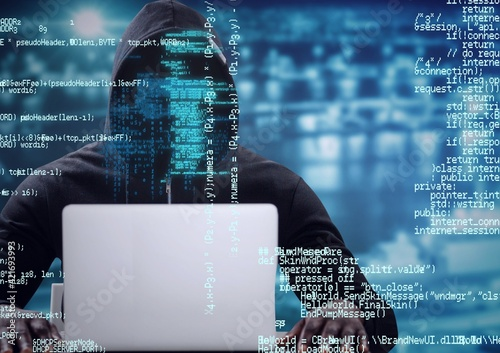 Composition of binary coding over hacker in hood using laptop