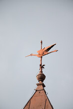 Vertical Shot Of A Weathervane On A Tower Of A Building
