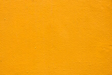 Yellow Wall Texture Background, Yellow Or Orange Painted Plaster Cement Wall Vintage Style. (For Abstract Background Uses)