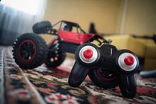 Remote Control Car On The Floor Of Living Room.