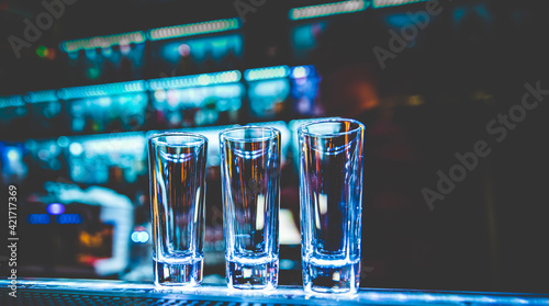 Empty glasses for shots on bar counter Fotobehang