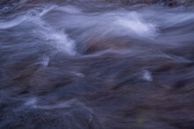 Water Flowing Over Rocks. Long Exposure. Abstract Background.