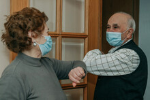 Grandparents Or Seniors Saluting Each Other With A Mask In The Coronavirus Pandemic