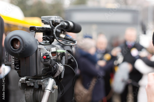 Fototapeta Close-up Of Television Camera With People In Background obraz