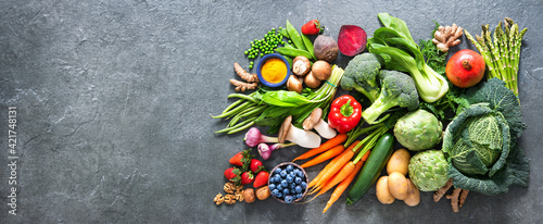 Healthy food selection with fruits, vegetables, seeds, superfood and cereals