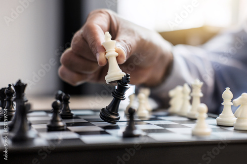 Fotografiet Midsection Of Businessman Playing Chess