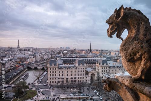 Fotografie, Obraz Gargoyle In City Against Sky