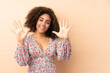 Young African American woman isolated on beige background counting ten with fingers