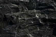 Black Rough Stone Wall Texture For Background Or Wallpaper.