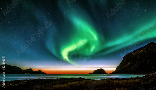 Fotografie, Obraz Scenic View Of Sea And Mountains Against Sky At Night