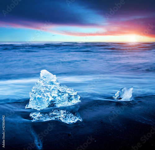 magical charming beautiful landscape with a piece of ice like a sculpture on the Diamond beach near glacier lagoon Jokulsarlon, Iceland. Exotic countries. Amazing places. Wall mural