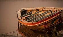 Old Boat Moored In River