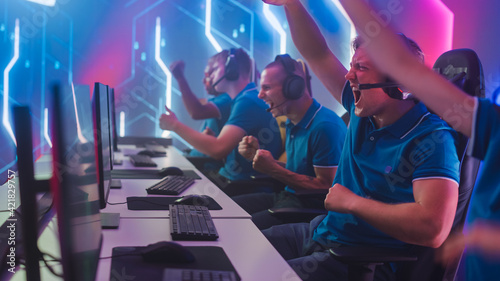Photo Diverse Esport Team of Pro Gamers Play in Computer Video Game and Win Championship, Celebrate with YES Gestures