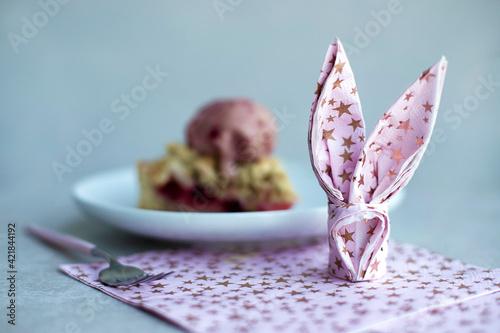 Fototapeta Close-up Of Pink Napkin Bunny Fold On Table obraz