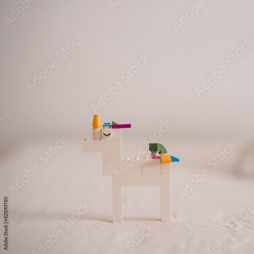 Photo Unicorn made of plastic bricks