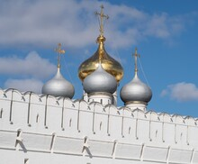 Domes Of The Smolensk Cathedral On The White Defensive Wall Of The Novodevichy Convent Against The Background Of Blue Sky, Moscow 2021