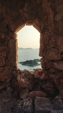 View Of Sea Seen Through Arch Window