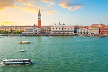 Massive Summer Crowds Line The San Marco Square, Campanile, Doge's Palace And St. Mark's Cathedral, As Seen From The Sea As Boats Pass By