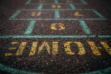 Ground Level Photo Of Hop Scotch Game On Pavement.