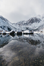 Beautiful Shot Of Mountains Reflecting In Convict Lake, California In Winter
