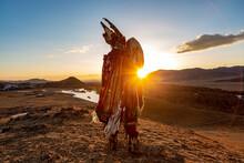 Mongolia Shaman Holding Drum Doing Authentic Ritual Of Summoning Spirits.sunset Moment