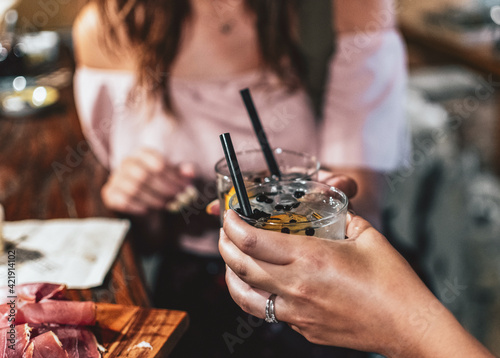 Fotografie, Obraz Closeup Of Two Women In Bar On Night Out