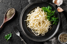 Tasty Appetizing Classic Italian Spaghetti On A Plate With Parsley And Spices Over A Dark Background, Top View. Concept Of Clean Eating