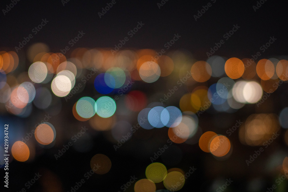 Fototapeta Defocused Image Of Illuminated Lights At Night
