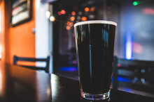 Close-up Of Dark Beer Glass Pint On Table