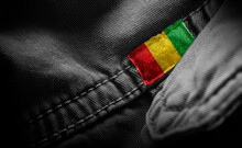Tag On Dark Clothing In The Form Of The Flag Of The Guinea