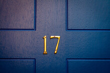 House Number 17 On A Blue Wooden Front Door In London