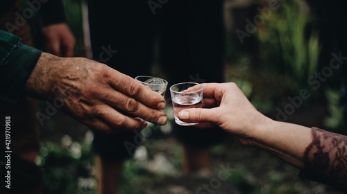 Fotografie, Obraz Midsection Of Man Holding A Glass Of Vodka