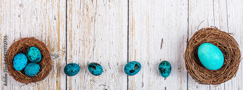 Fotografia, Obraz High Angle View Of Blue Eggs On Wooden Table