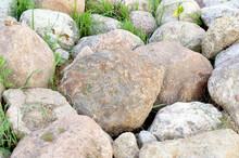 Large Stones Lie Quietly On The Shore In The Water Of A Forest Lake