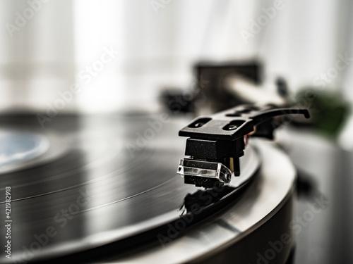 Obraz Turntable plays a vinyl record  - fototapety do salonu