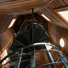 Metal Spiral Staircase Inside An Old Wooden Fire Tower