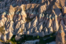 Colourful Rock Formations Situated On A Hillside Near Goreme In The Cappadocia Region Of Turkey. Eventually These Formations Will Become Fairy Chimneys Such As The One In The Lower Right Of Frame.