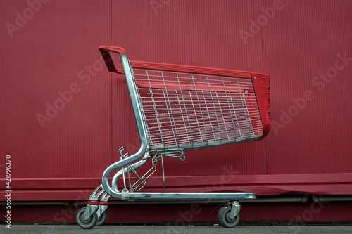 Fotografering Side View Of Red Trolley Against Wall