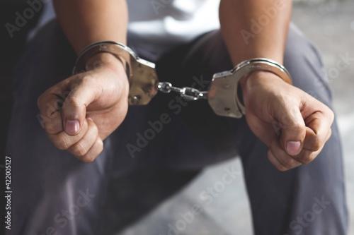 Valokuvatapetti Handcuffed Prisoner In Jail
