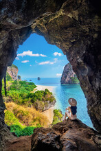 Woman Sitting In The Cave At Railay, Krabi, Thailand.