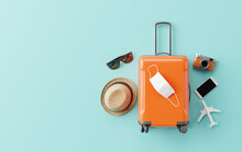 Flat Lay Orange Suitcase With Face Mask And Travel Accessories On Blue Background. 3d Rendering